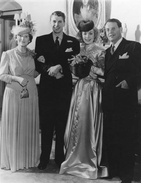 1940. Ronald Reagan and Jane Wyman on their wedding day on January 26, 1940 - p872